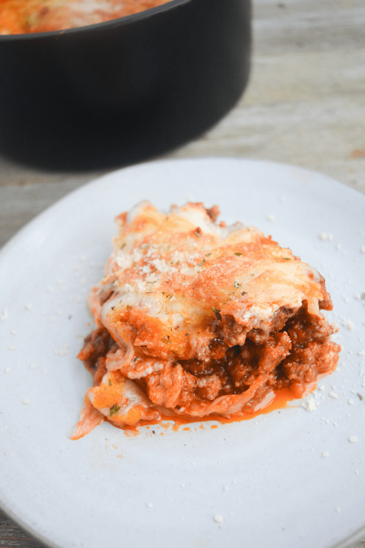 single serving of air fryer lasagna on a white plate